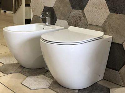 sanitari wc bidet a terra filo muro ceramica bianca forma arrotondata arredo bagno